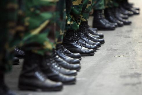 Army soldier's boots are seen during a preparation for a state funeral for the killed Bangladesh Rifles officers in Dhaka.